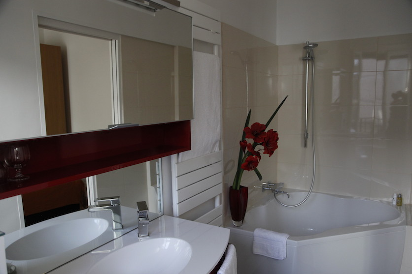 Bathroom with shower and bath, sink and WC