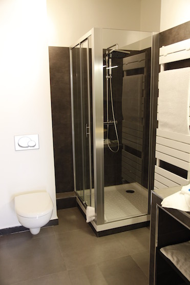 Bathroom with shower, sink and WC